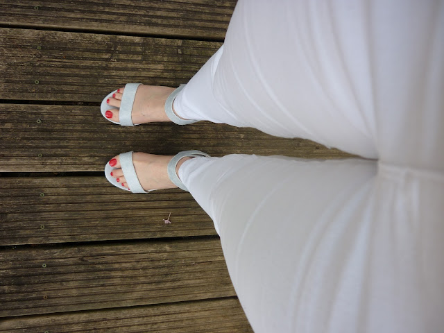 View of White Jeans and Blue Sandals