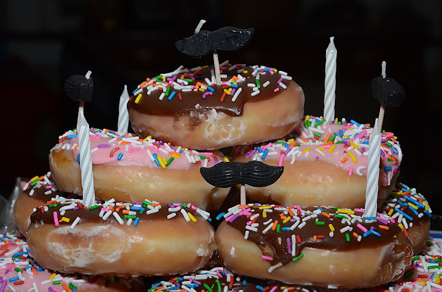 Throwing a Surprise Party + moustaches and Krispy Kreme doughnut cake