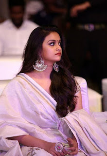 Keerthy Suresh in White Dress with Cute Smile at Pandem Kodi 2 Pre Release Event in Hyderabad 4