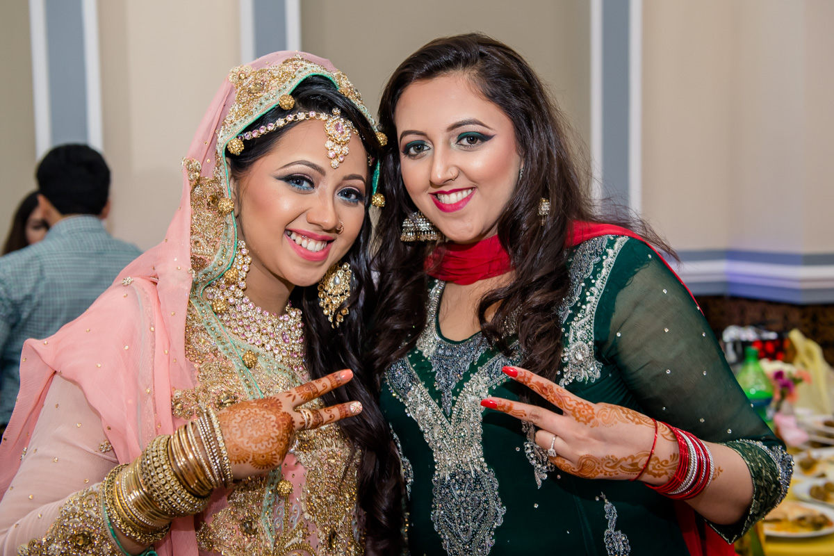 Bride Expressing Her Deep Satisfaction And Joy With Friends.