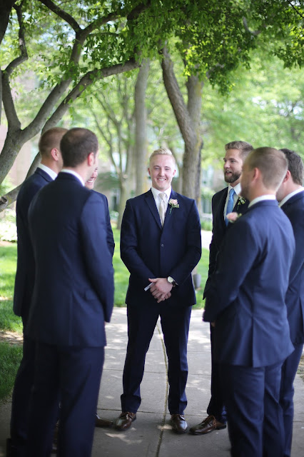 groomsmen in navy Marina Inn Sioux CIty wedding