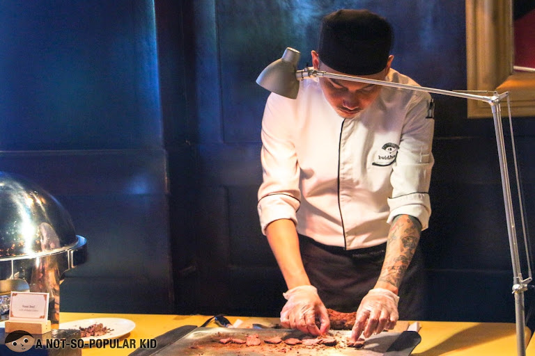 Slicing steak in Buddha Bar Manila