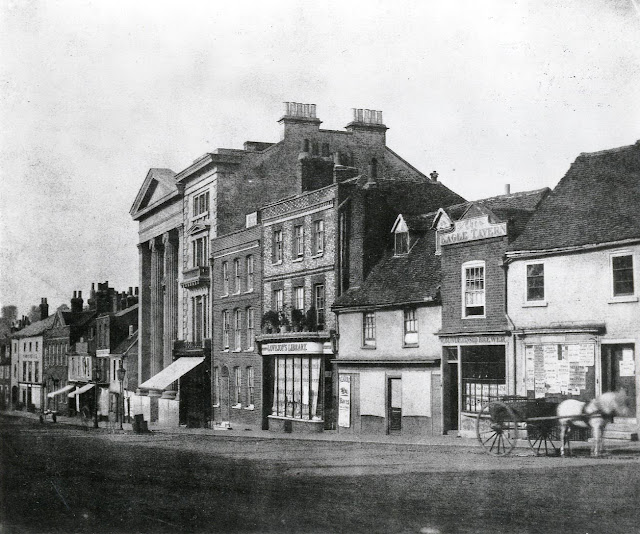 London Street, Reading. East side, c. 1845. No. 33 (Reading Literary, Scientific and Mechanics' Institution); No. 39 (Lovejoy's Library, bookseller, circulating library, post office, and stationer's); No. 41 (with poster for Reading Races); No. 43 (The Eagle Tavern). A horse and cart waits outside the inn. 1840-1849 : photograph by W. H. Fox Talbot. The original is in the Science Museum/Science and Society Picture Library.