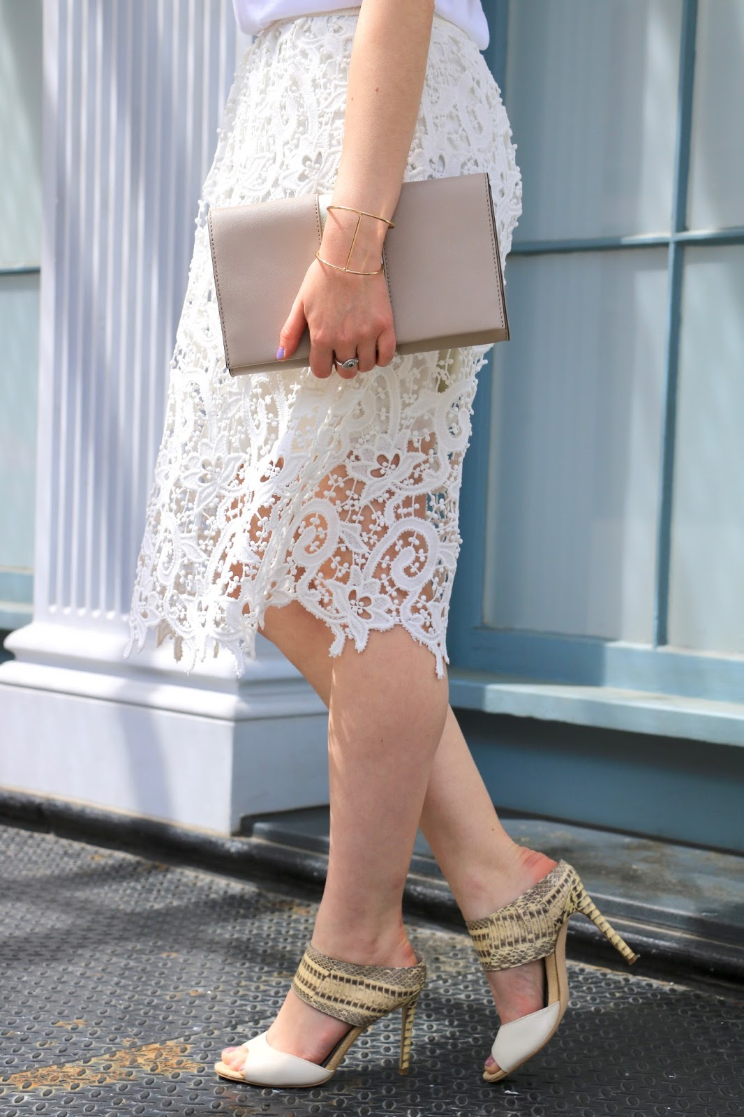 nyc fashion blogger Kathleen Harper wearing a white lace pencil skirt with white heeled mules