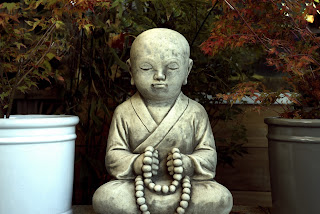 Picture of statue of child Buddha meditating