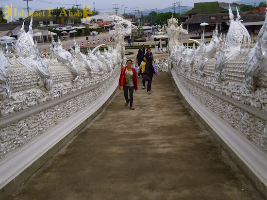 Visitors to Wat Rong Khun, Chiang Rai, North Thailand