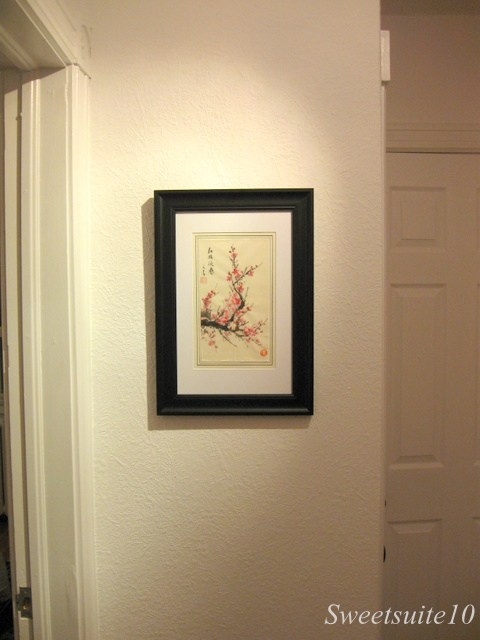 Cherry Blossom art hung on the wall