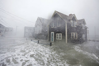 Waves from a winter storm in early March washed over houses in Scituate, Massachusetts, and flooded the streets. The nor'easter hit as tides were already high because of the nearly full moon. (Credit: Scott Eisen/Getty Images) Click to Enlarge.