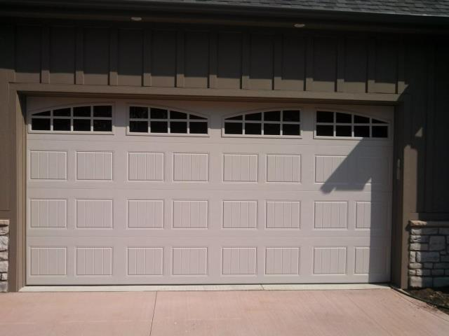 Captivating Pictured Above Is A Clopay Gallery Collection Short Panel Garage Door With  Long Panel Arch Windows. This Is A Great Look That Flows Together Well.