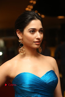 Actress Tamannaah Pictures in Blue Long Dress at Abhinetri Audio Launch  0021