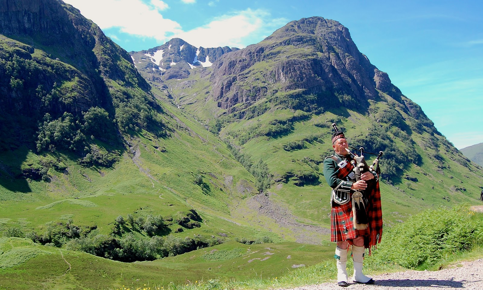 Bagpiper at the Three Sisters in Glencoe, Scotland