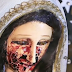 Mystery as 'blood' poured from the eyes of a statue of the Virgin Mary (Photos)