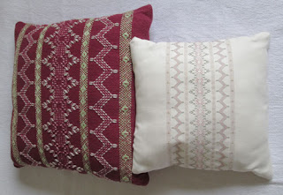 two cushions with stitching that forms patterns on the background fabric