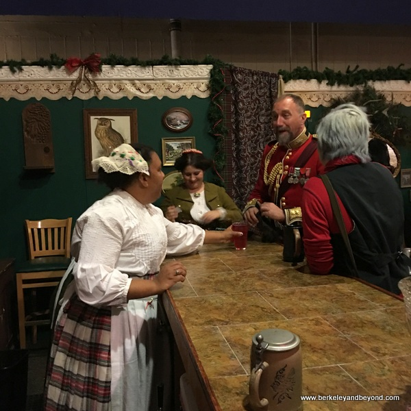 characters belly up to the bar at The Great Dickens Christmas Fair in San Francisco