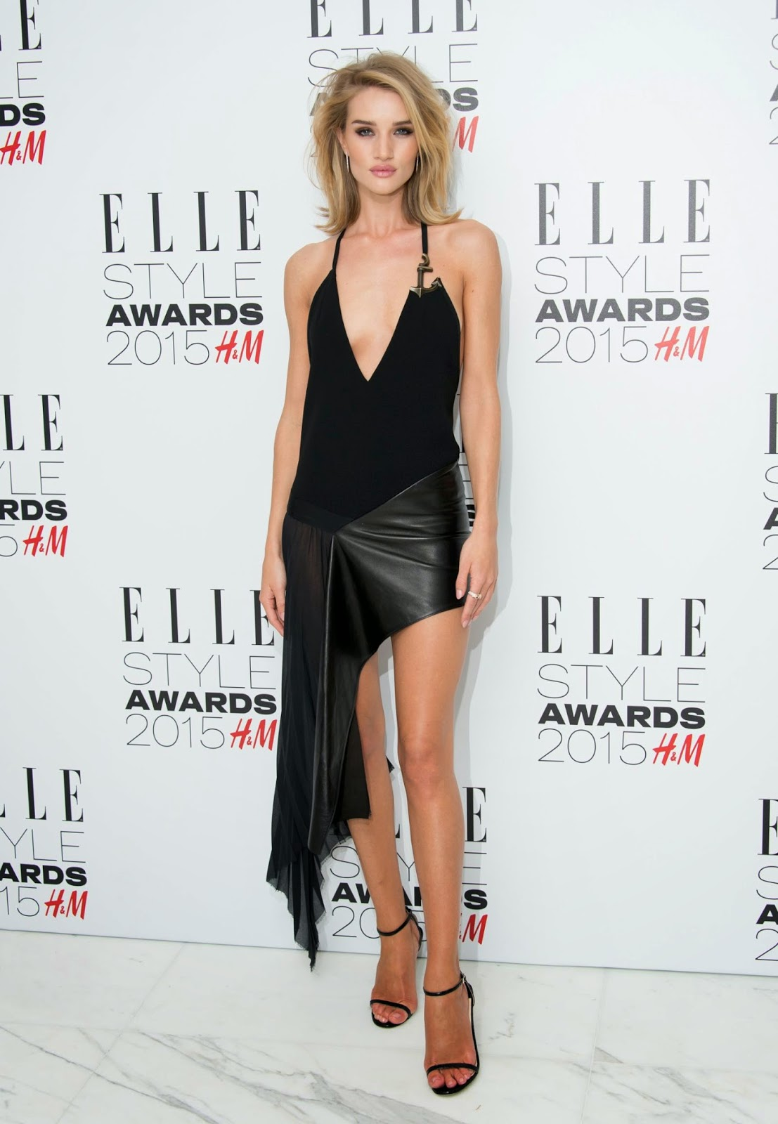 Rosie Huntington-Whiteley flashes skin in a leather and suede dress at the 2015 Elle Style Awards in London