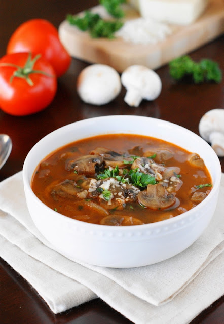 Hearty homemade Tomato-Mushroom Soup is loaded with fresh mushrooms and full of rich and delicious flavor.  Warm, comforting, and tasty, it's the kind of good food that just makes you feel good all over.