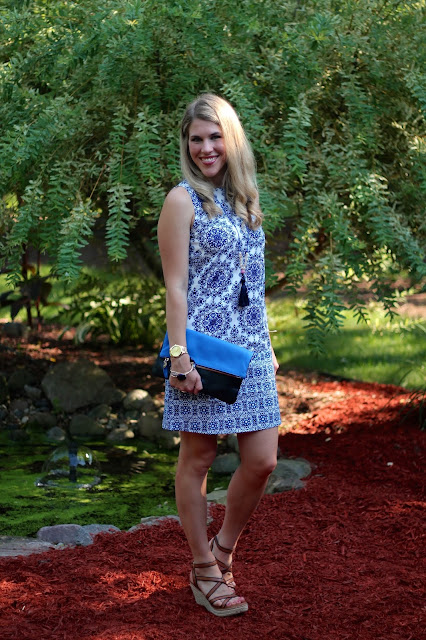 blue and white sleeveless dress, wedges, blue Clare V. clutch, tassel necklace