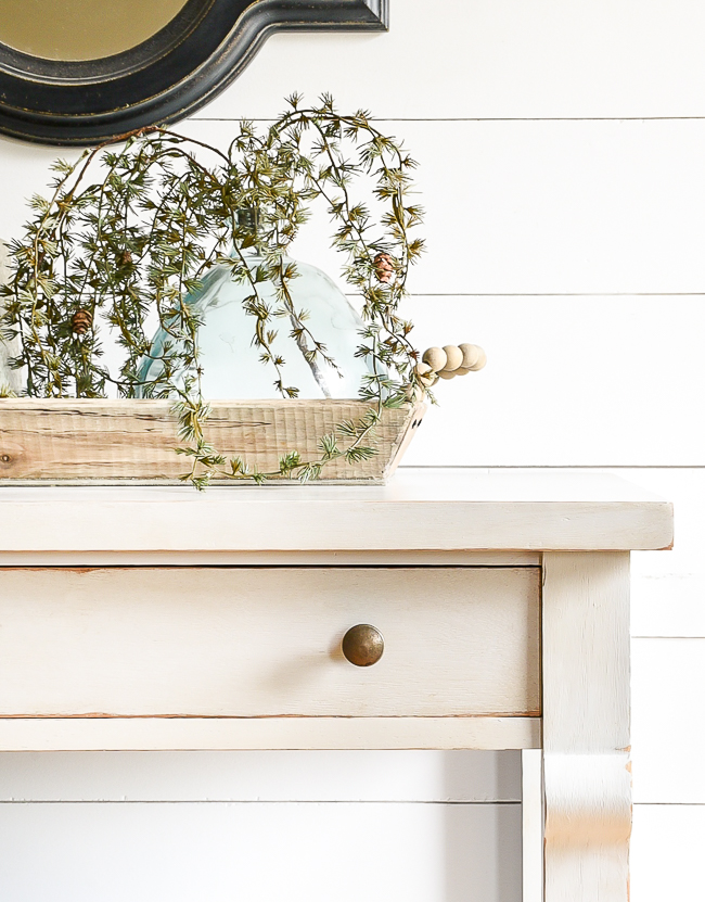 Gray painted console table with clear and dark wax