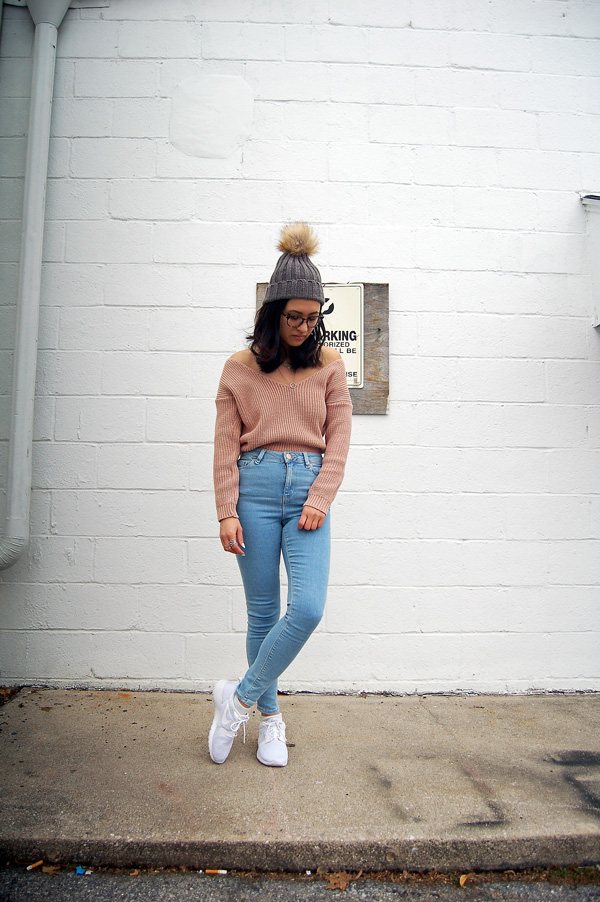 pink sweater blue jeans white sneakers beanie