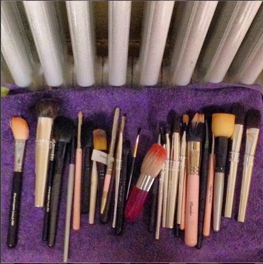 All the brushes are laying on a towel