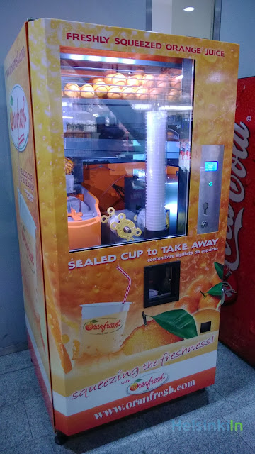 Orange juice vending machine at Kamppi Kauppakeskus