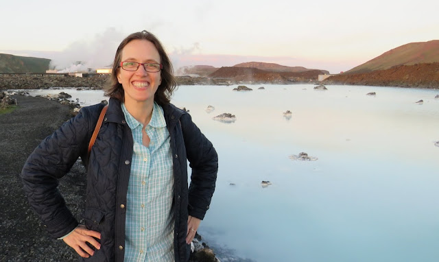 Part-time travel blogger, Jennifer (aka Dr. J) from Sidewalk Safari travel blog. Photo taken at the Blue Lagoon in Iceland.