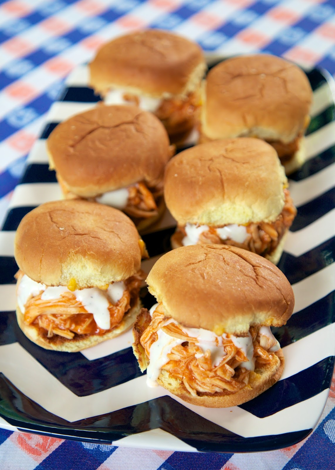 Slow Cooker Buffalo Chicken Sliders -  only 3 ingredients! Chicken, Buffalo sauce and Ranch! These things are SO good! GREAT for tailgating. Can serve on buns, nachos, tacos or on top of a salad. Can freeze leftovers!