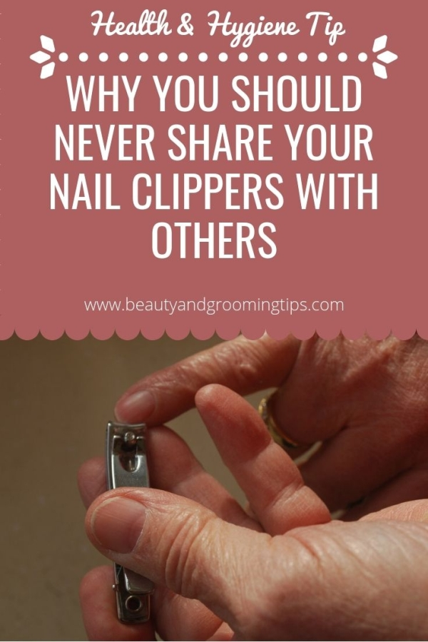 woman cutting her finger nails with a nail cutter / clipper