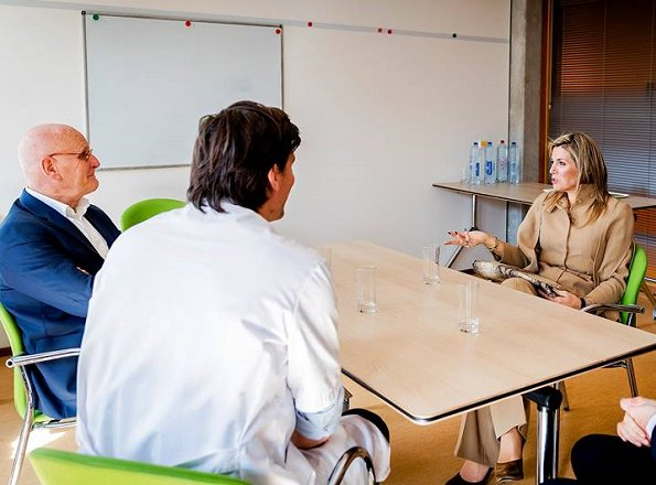 Queen Maxima wore Valentino camel-colored Pant Suit during visit to the psychiatry department of the Academic hospital in Amsterdam