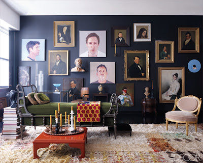 a gallery wall with different sizes of portraits via belle vivir blog