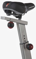 Example of a 4-way adjustable seat on an exercise bike, adjusts up down fore aft