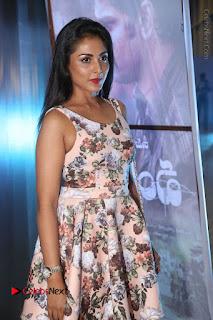 Actress Madhu Shalini Stills in Floral Short Dress at RGV Shiva to Vangaveeti Event  0026.JPG