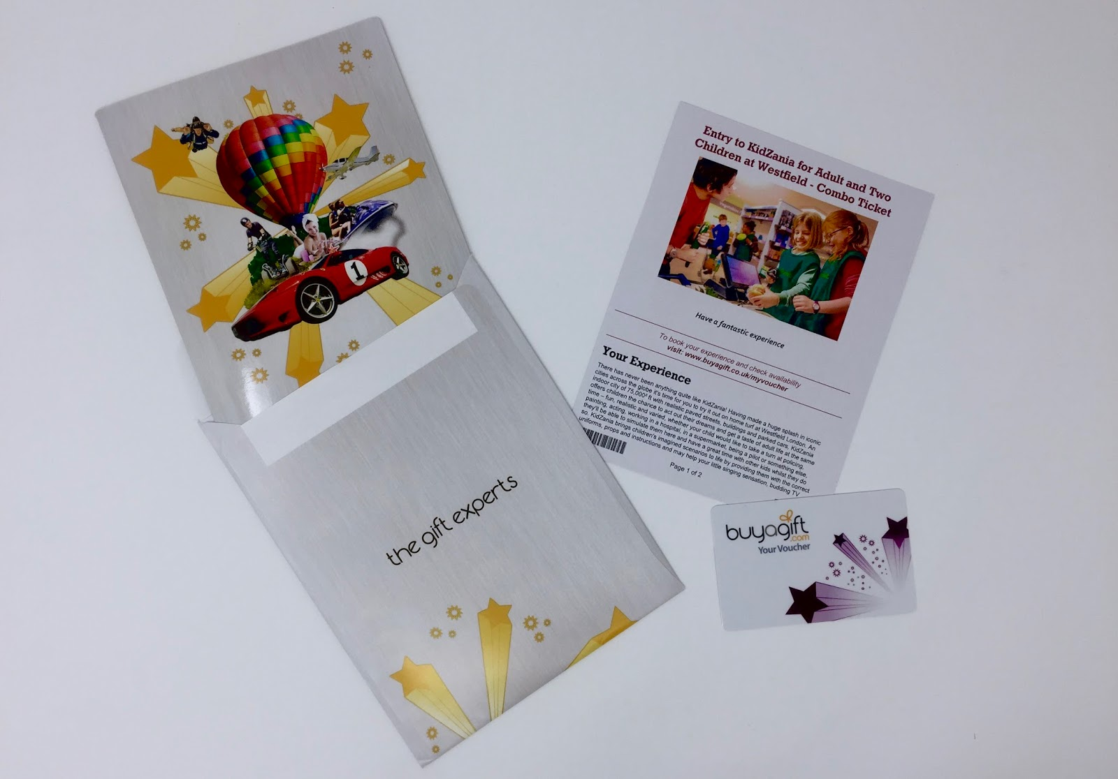 An envelope, a card, a printed description of the experience and a gift card for Kidzania from Buy a Gift