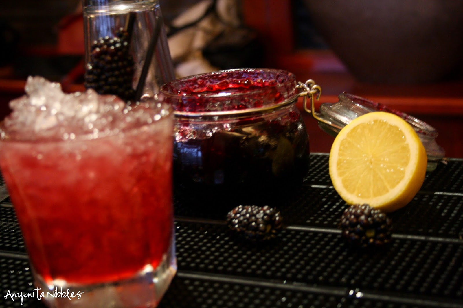 The main components of the Drunken Vimto are blackcurrant jam, blackberries and lemon juice. From Anyonita Nibbles
