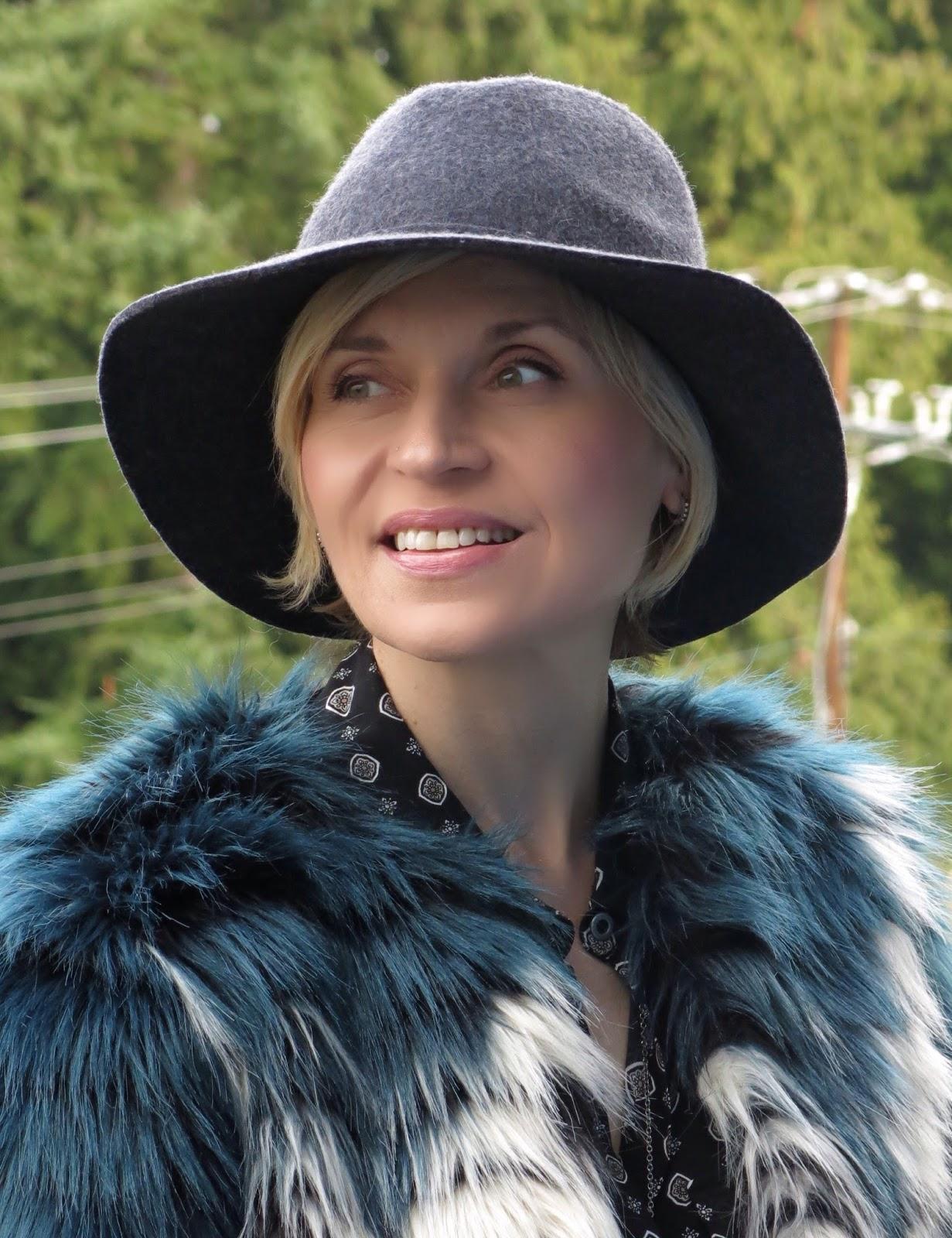 faux-fur jacket, patterned shirt, floppy hat