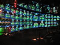 Menakar Resiko dan Keuntungan Investasi Saham