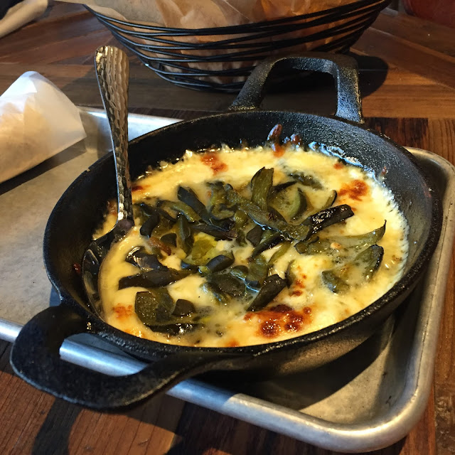 Queso Fundido is a fun appetizer at Beloit, Wisconsin's truckt that features manchego cheese, chihuahua cheese and poblano peppers.