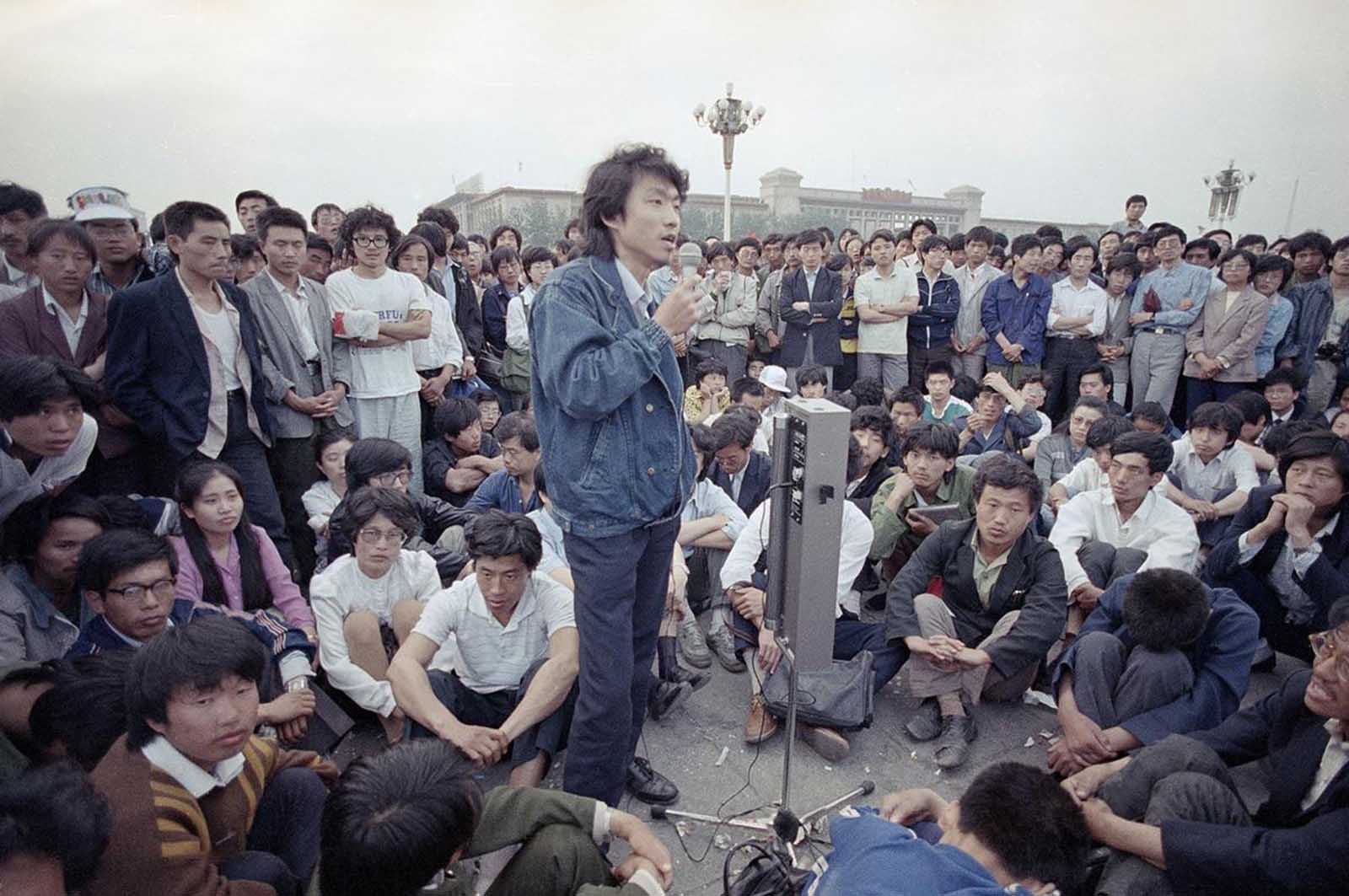 Beijing University students listen as a strike spokesman details plans for a rally in Tiananmen Square, which they have occupied for the last two weeks, on May 28, 1989.