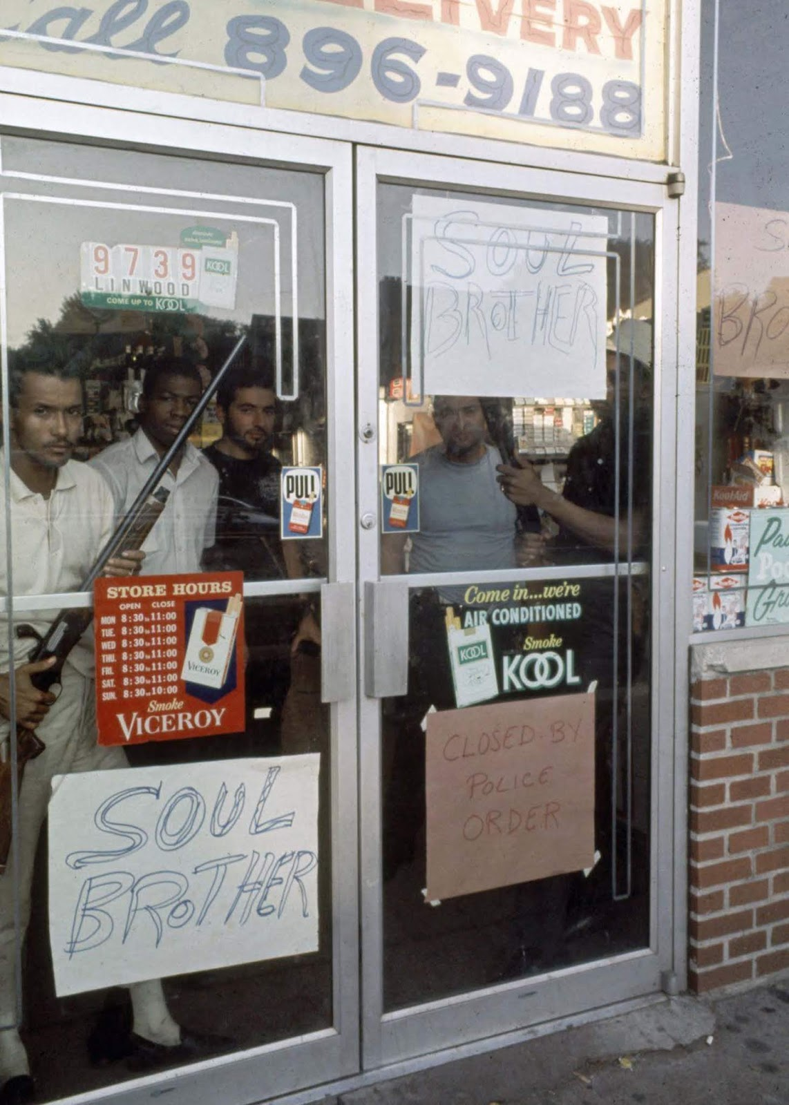 African-American store owners protecting their store with rifles.