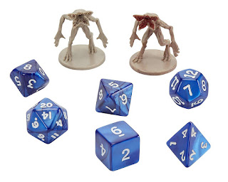 Demogorgon miniatures and dice included