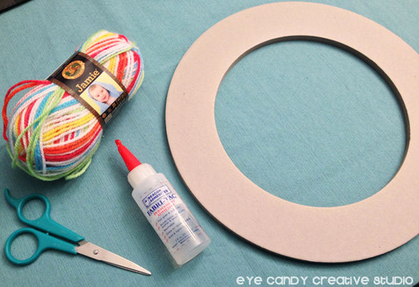 supplies needed to make a yarn wreath, rainbow party decor craft
