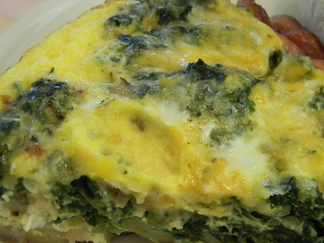 spinach, mushroom and potato frittata with bacon on a plate
