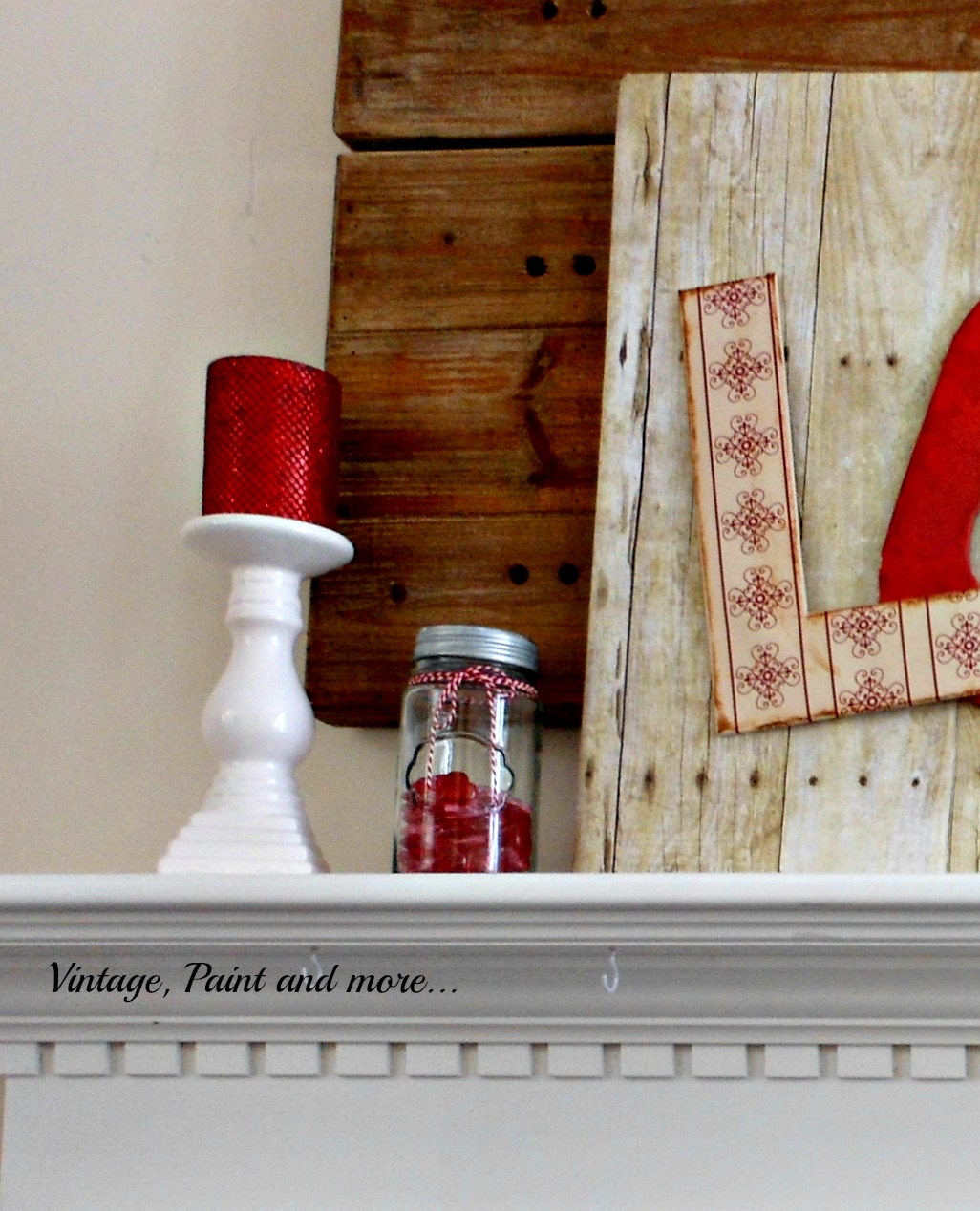 A simple mantel DIY'd for Valentine's with scrapbook paper crafts and mason jar