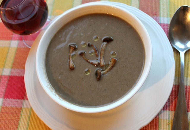 Food Lust People Love: This wild mushroom soup, topped with beautiful pan-fried brown beech mushrooms and a drizzle of truffle oil is based on Anthony Bourdain's Les Halles recipe. It's rich and comforting, a great bowl for a cold night or a light lunch.