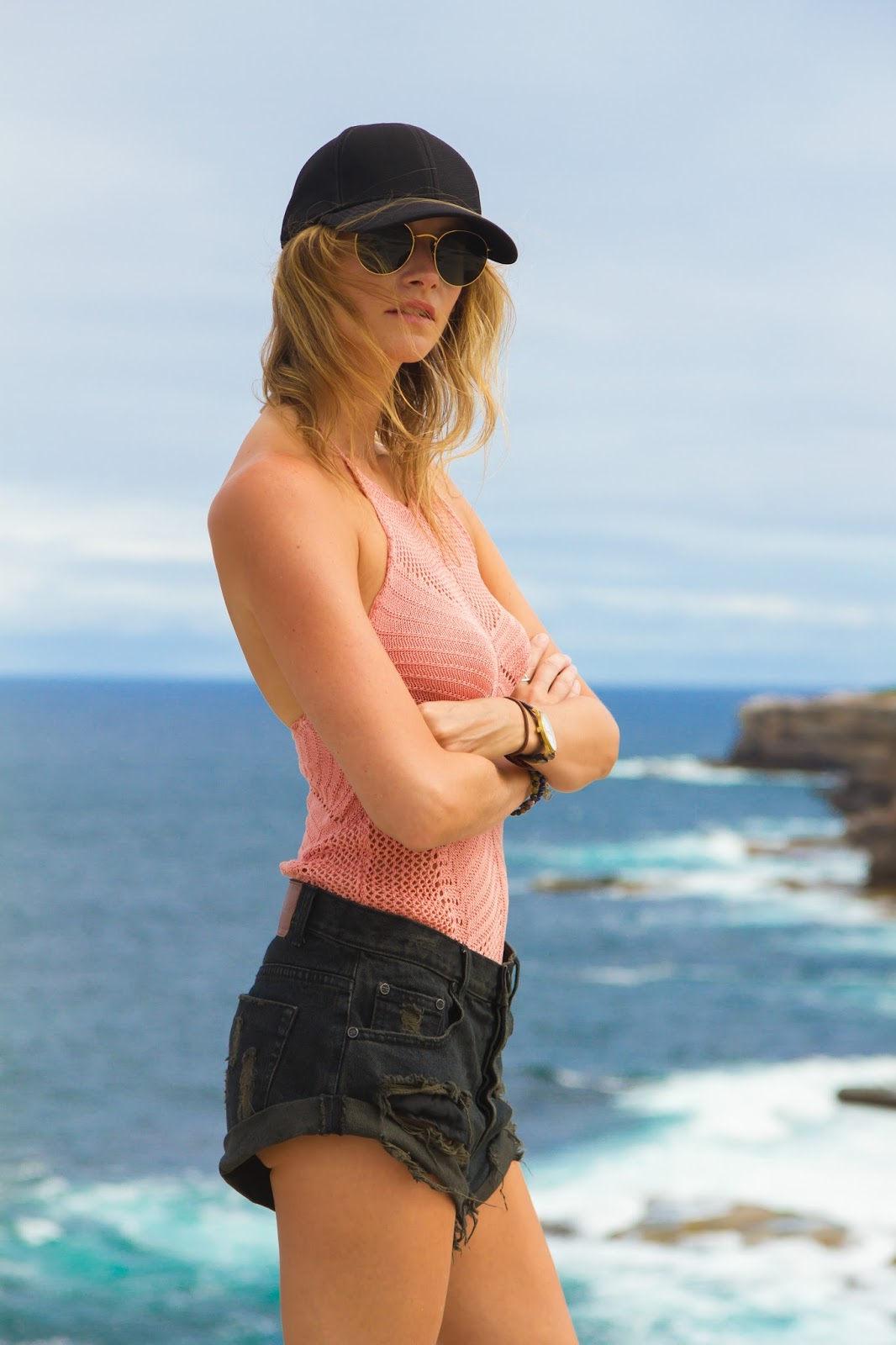 fashion and travel blogger, Alison Hutchinson, at the cliffs of Kurnell in Sydney Australia