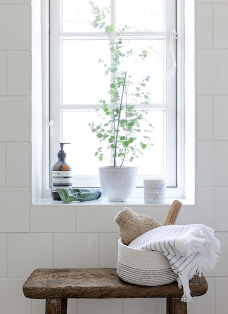 Modern farmhouse style in rustic bathroom with white tile and wood stool by Tine K