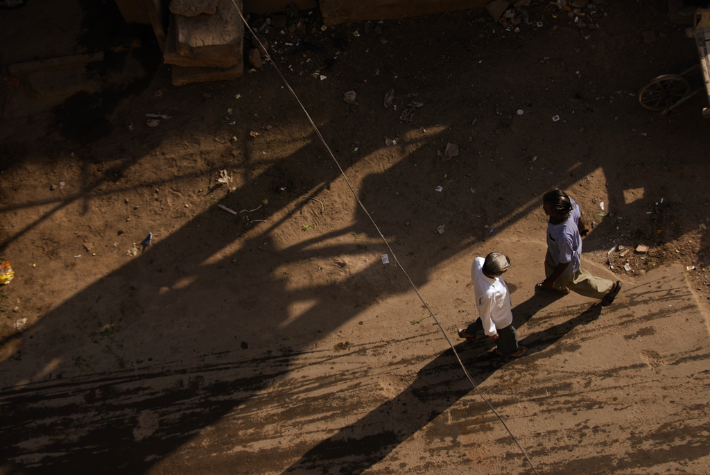 Photo of people walking in a street in India.