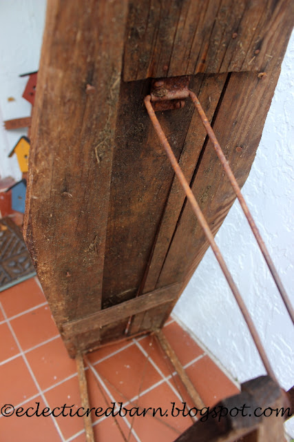 Eclectic Red Barn: Old ironing board with rusty legs and loaded with straw