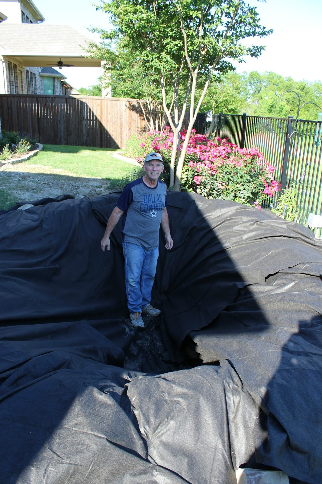 Building a backyard pond part 3 poofing the pillows for Homemade koi pond