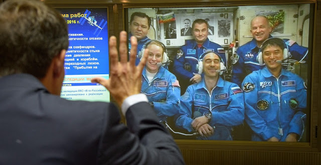 Family and friends talk to Expedition 48 Flight Engineers Oleg Skripochka, top left, and Alexey Ovchinin of Roscosmos, top center, along with Expedition 48 Commander Jeff Williams of NASA, top right, NASA astronaut Kate Rubins, bottom left, cosmonaut Anatoly Ivanishin of Roscosmos, bottom center, and astronaut Takuya Onishi of the Japan Aerospace Exploration Agency (JAXA) from the Moscow Mission Control Center after Rubins, Ivanishin, and Onishi docked their Soyuz MS-01 spacecraft to the International Space Station, Saturday, July 9, 2016, Korolov, Russia. Photo Credit: (NASA/Bill Ingalls)